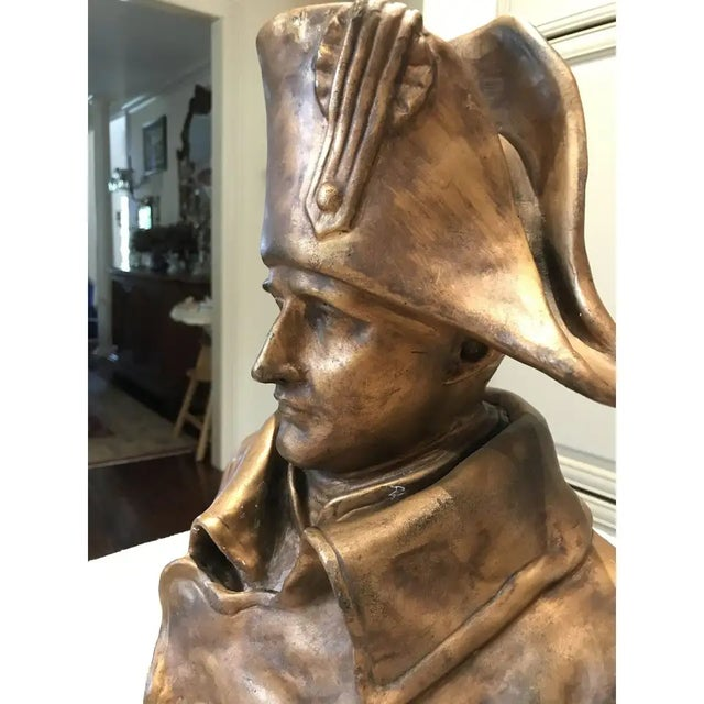 A handsome bronze bust of Napoleon Bonaparte with a coppery gold patina from the 19th century and signed on the back by...