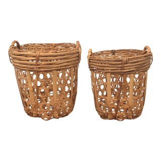 1970s Vintage Rattan Nesting Baskets - A Pair For Sale