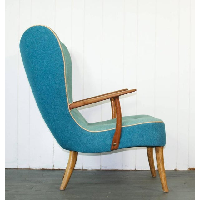 Madsen and Schubell Pragh sculptural lounge chair. Soft wool upholstery with leather piping and buttons.
