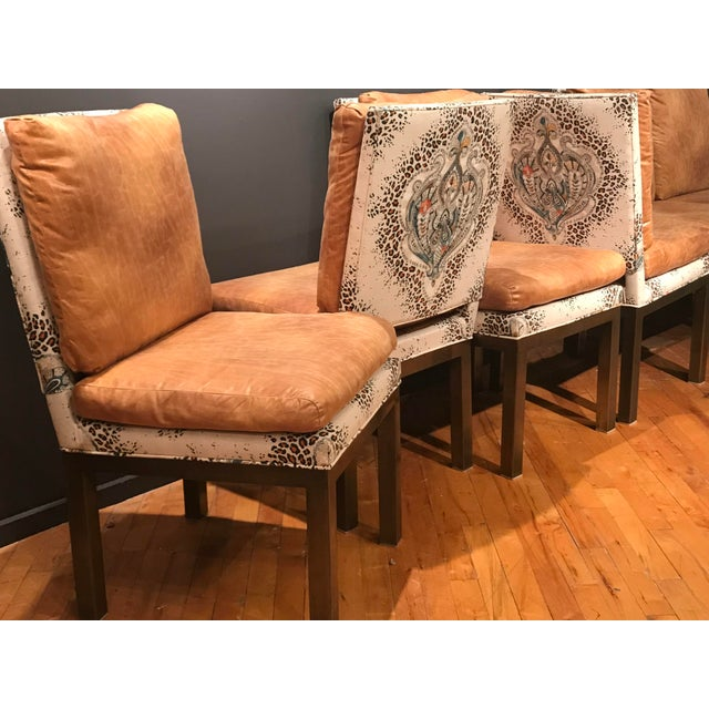 These fantastic dining chairs have solid brass legs. the have an upholstered base in one fabric and the top attached...