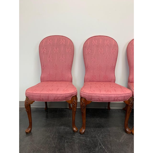 A set of four dining side chairs by John Widdicomb. Made in Grand Rapids, Michigan, USA circa 1980s. Mahogany frames with...