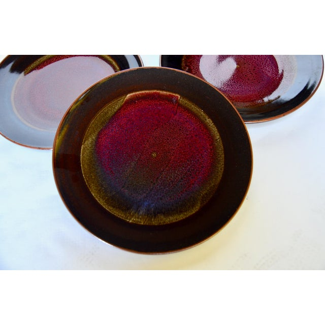 A gorgeous set of 8 dinner plates by Berkeley ceramic artist, Gary Holt. Known for his rich and varied glazes, these are...