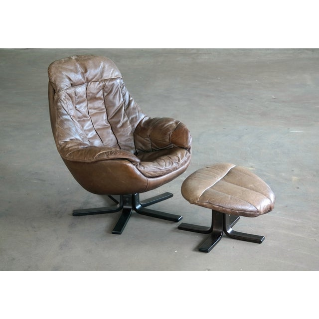 Great high back swivel lounge chair model Silhouette and matching ottoman designed by H.W. Klein for Bramin Mobler,...