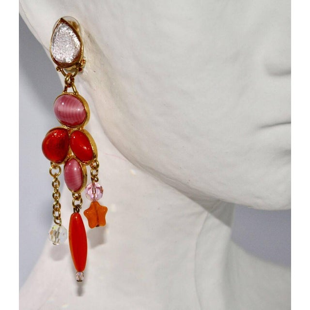 Vintage 1990's glass and crystal clip earrings in pink and orange from Philippe Ferrandis. * Due to the unique nature of...