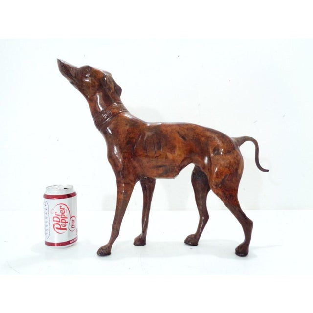 """Handsome bronze colored iron Whippet/Greyhound statue. Large ~ 17"""" L x 14.5"""" H and is heavy. Excellent condition with..."""