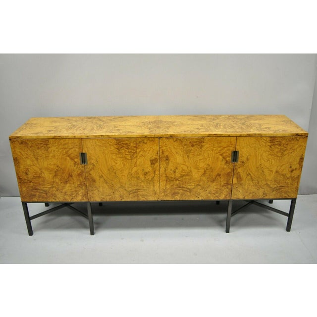 Roger Sprunger for Dunbar Burled Olivewood Credenza Cabinet. Item features metal x-frame stretcher and base, beautiful...
