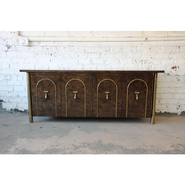 A stunning 1970s Mastercraft credenza or sideboard designed by William Doezema. The credenza features glossy dark burled...