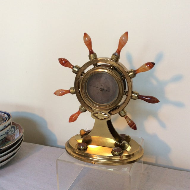 Great looking agate and brass nautical themed Barometer with agate ships wheel handles and inscribed Marshall & Son....