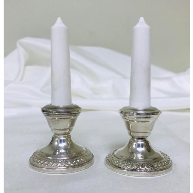 Circa 1930s pair of LaPierre Sterling Silver figural salt and pepper shakers in the form of candlesticks. The are...