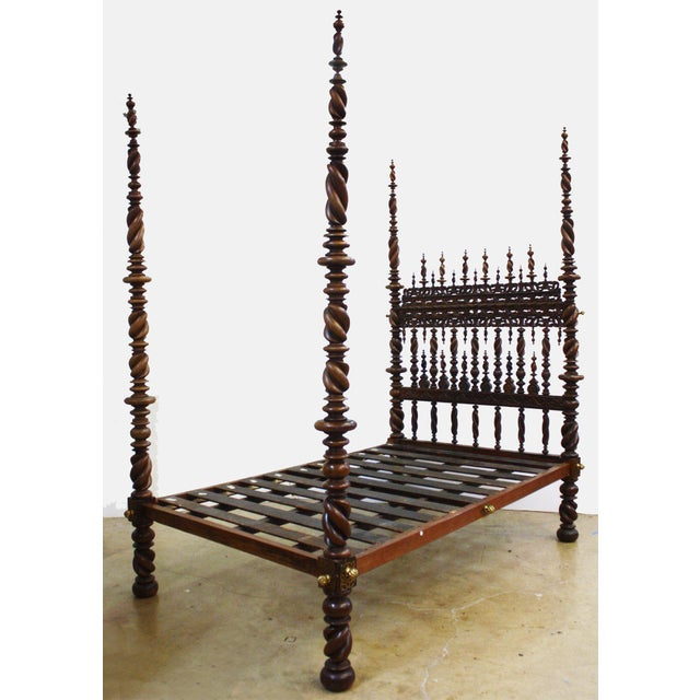 a 17th century Portuguese bed of carved and turned rosewood, the headboard profusely mounted with spiral-twist spindles...