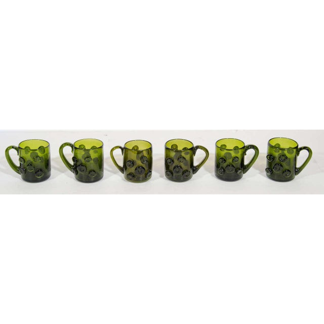 Set of six charming handblown glass mugs perfect as espresso cups or liqueur glasses. The glasses have a beautiful emerald...