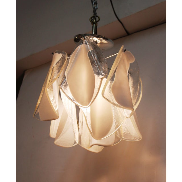 Italian modern diminutive glass handkerchief pendant light. The piece was made during the 1970s and takes one light bulb....