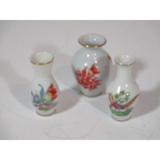 """Wonderful group of Herend hand painted porcelain consisting of the following: red floral bud vase with gold trim, 1.75 """"..."""