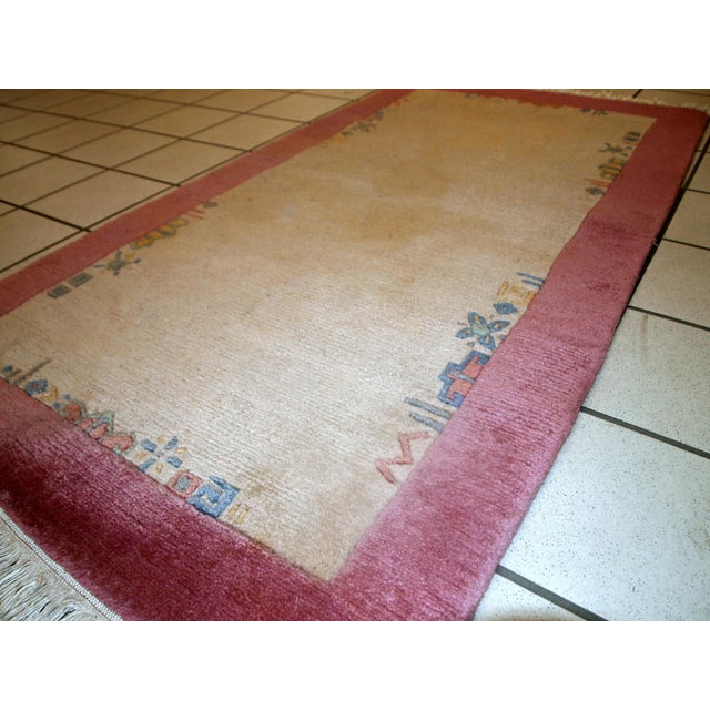 Vintage hand-woven rug from nepal in original good condition. It has been made from wool in the end of 20th century....
