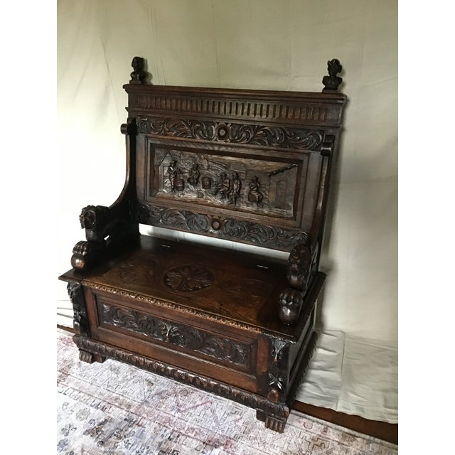 Victorian era solid oak James Schooolbred bench and chest. Beautifully carved pub scene back, carved lion armrests and...