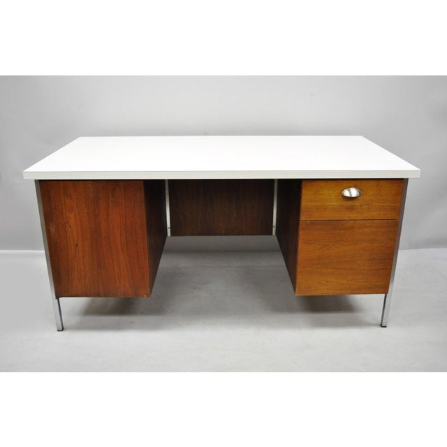 Vintage Florence Knoll Walnut executive desk with laminate top. Item features chrome frame, white laminate top, 2 drawers,...