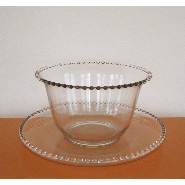 Stunning Imperial Candlewick set featuring a large punch bowl, platter or underplate and twelve (12) cups! This is a...