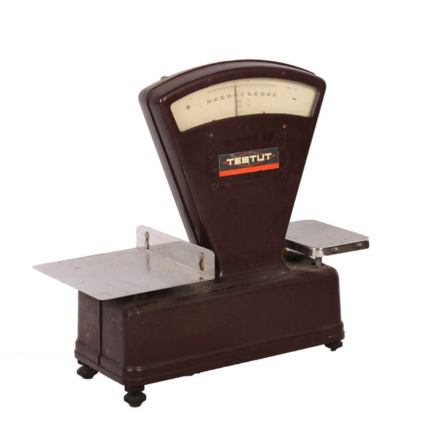 A vintage enameled general store scale by Testut featuring 2 scales. Dial and plate are functioning but it does not...