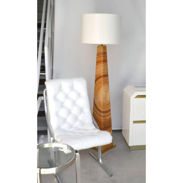 Striking midcentury cut reed floor lamp, circa 1960s-1970s. This incredible artisan crafted standing lamp of pyramid /...