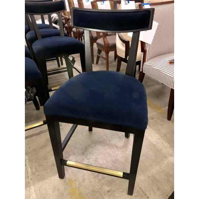 Fairfield counter stools with a dark blue velvet. The finish is an ebony with strong red undertones. A brass kick plate...