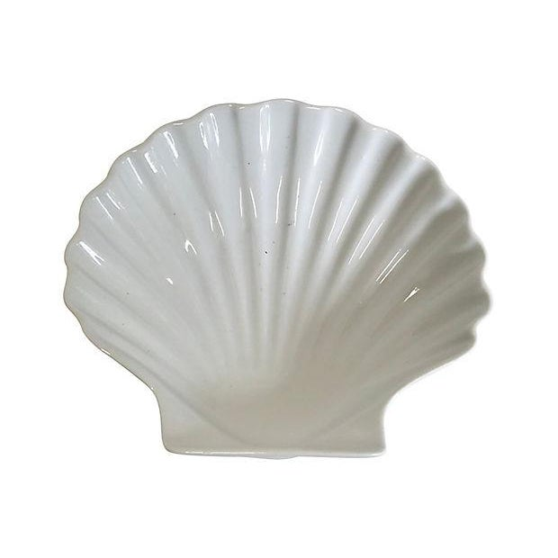 "Set of 12 porcelain shell-shaped appetizer plates. Marked: ""Traditions, France"" on the underside."