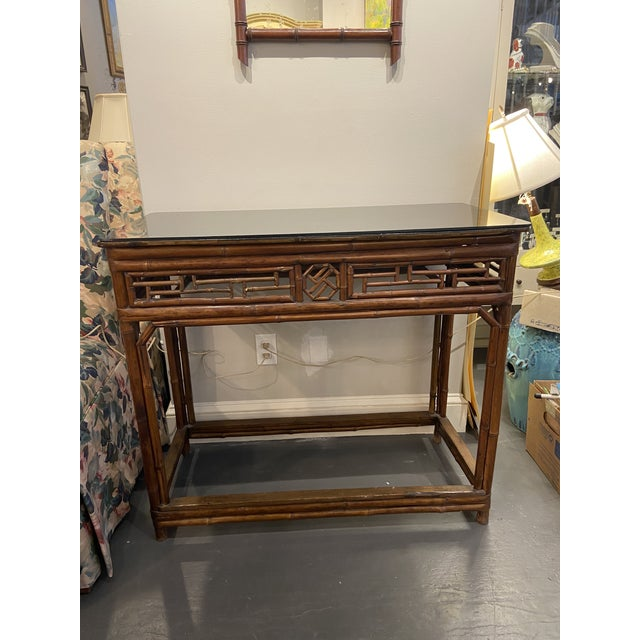This is a beautiful console table. It's bamboo black walnut vase is stunning snd in great condition. The detail on the...