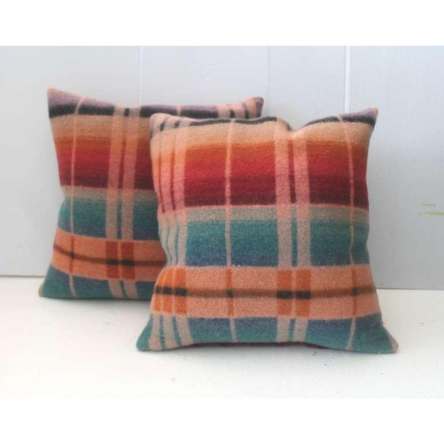 These soft wool pastel pillows were cut from a 19th century horse blanket. The backing is a antique red cotton linen. Sold...