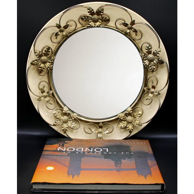 A unique Vintage Convex Mirror with a Golden Gilt Tole Floral Border, and a cream colored background. Made in England...