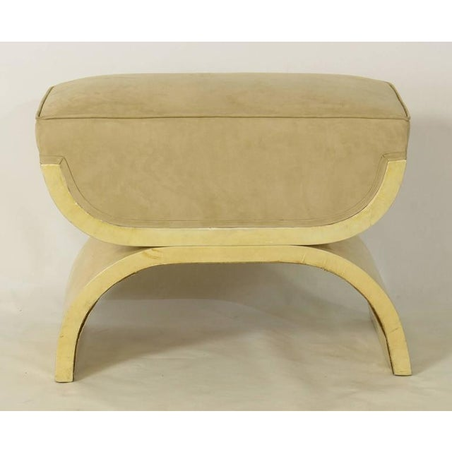 A sleek and elegant Art Deco Karl Springer Inspired ottoman or stool covered in a cream colored lacquered goatskin with...