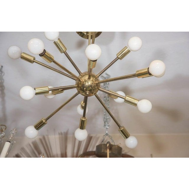 A vintage Sputnik chandelier, with fifteen arms and socket covers, extending from the central nucleus, suspended from a...