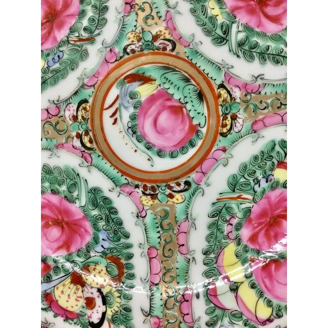 Decorative plate hand painted in Macau. This pretty vintage plate has the colors of the season. Brighten up any room with...
