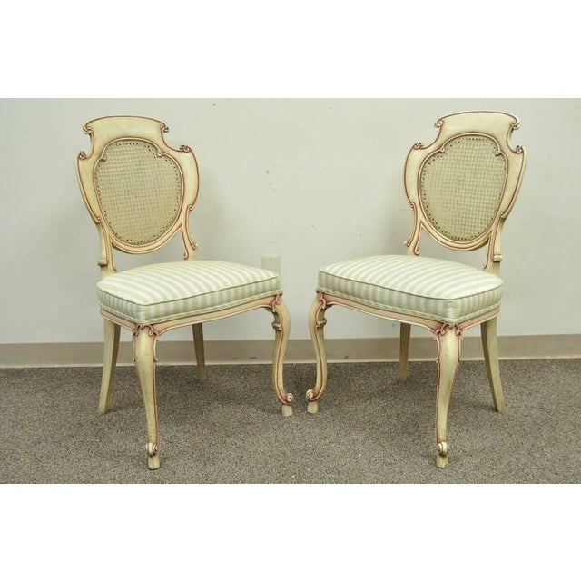 French 1950s Vintage Scroll Carved Italian Hollywood Regency Cream Pink Cane Back Dining Chairs- 4 Pieces For Sale - Image 3 of 11