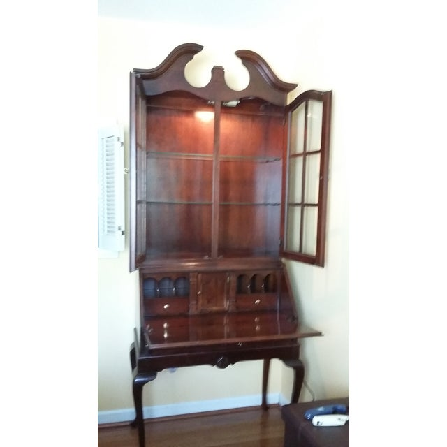 Vintage-style, solid cherry wood secretary's desk with lighted display hutch. Desk part has six small cubby holes, one...