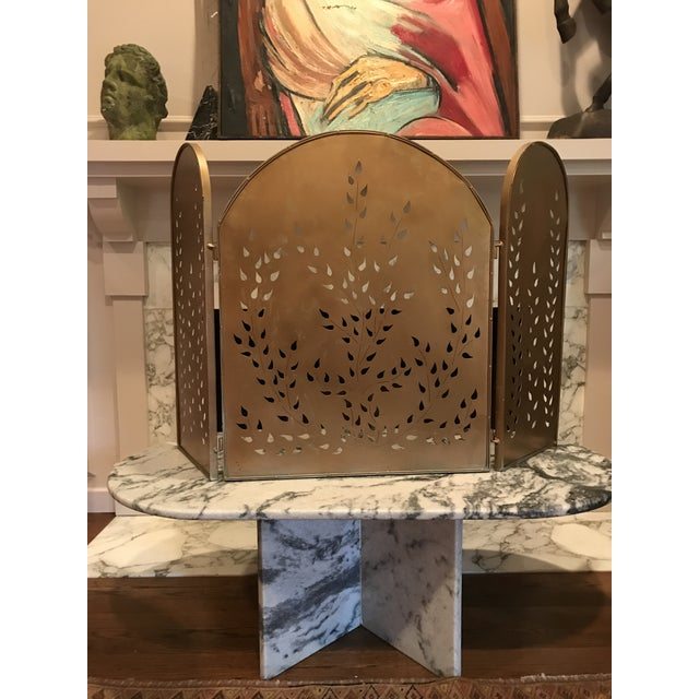 Heavy, cut metal, vintage Mid-century modern fireplace screen painted gold.