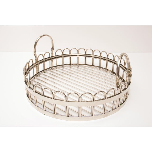 This handsome and substantial serving tray is by the iconic silver-maker Godinger. The piece has collapsible handles for...