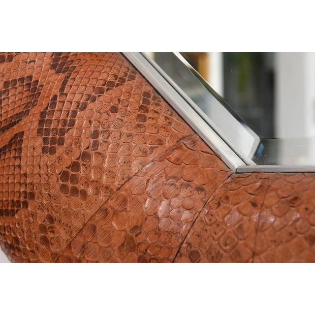 This handsome mirror has a polished steel frame, beveled mirror and dyed python skin this is the ultimate in quality and...