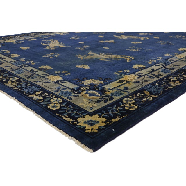 77266 Distressed Antique Chinese Peking Rug with Traditional Chinoiserie Style 09'01 x 13'07. This Distressed hand knotted...