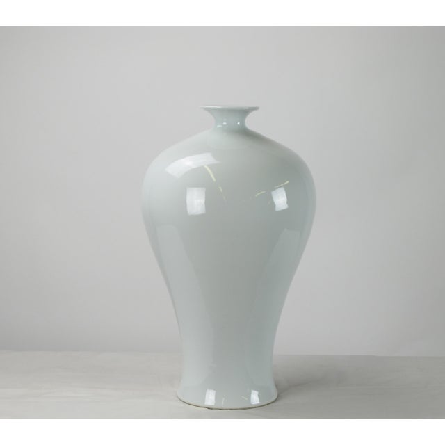This contemporary vase with glossy white finish and smooth high shoulders pose a simple streamline form. Each one is hand...