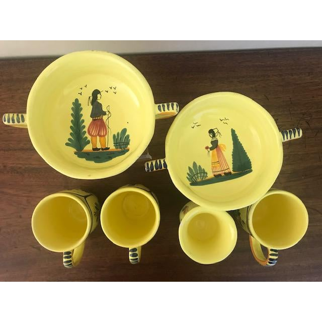This hand painted Quimper set includes two soup bowls, a double sided egg cup and three coffee or tea cups. They are a...