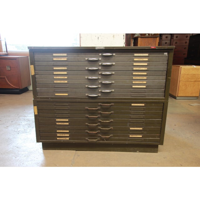Offering a vintage industrial 20-drawer metal blueprint flat file by Hamilton Manufacturing Company. There are two...