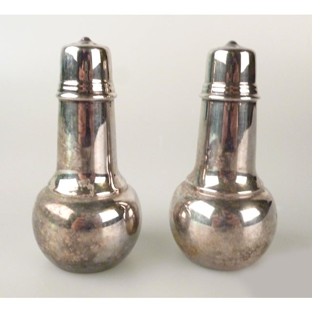 WM Rogers silver-plate salt and pepper shakers. Maker's mark on undersides.