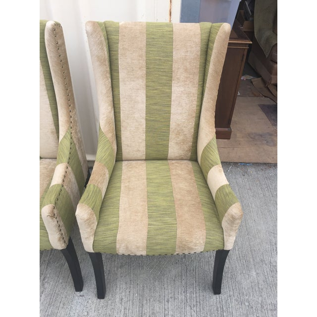 Set of two contemporary lounging chairs with nail head trim and velour fabric, in tones of green and Cafe Au lait. Very...