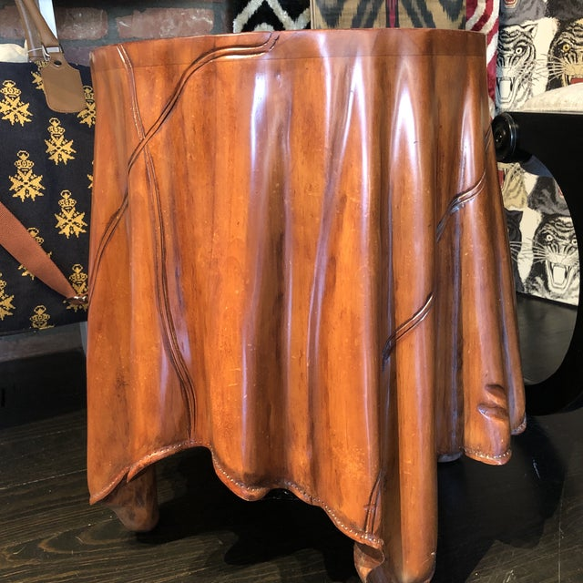 This table is 15 inches wide and 20 inches tall. This has a hand finished and hand carved light mahogany stain on hardwood.