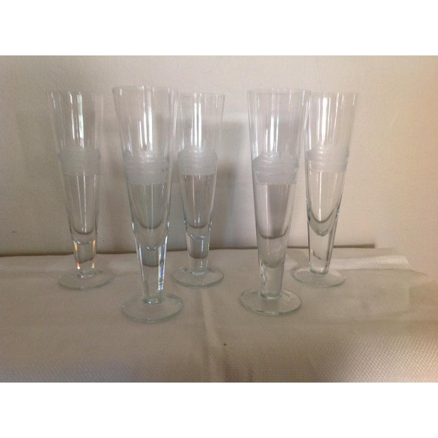 This set of five glasses have an etched image of a ship . The ship is very detailed .