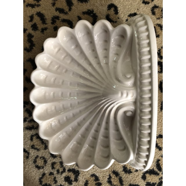 Beautiful pair of white porcelain shell wall brackets. Marked made in Italy.