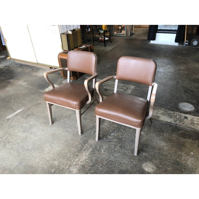 Pair of atomic era Steelcase arm chairs in beige and brown tones. Cool look, and extra comfortable. These versatile chairs...