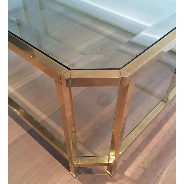 Roche Bobois Mid Century Modern Roche Bobois Two Tiered Brass Coffee Table With Octagonal Corners and Beveled Top Glass Circa 1970 Pair of Tables For Sale - Image 4 of 6