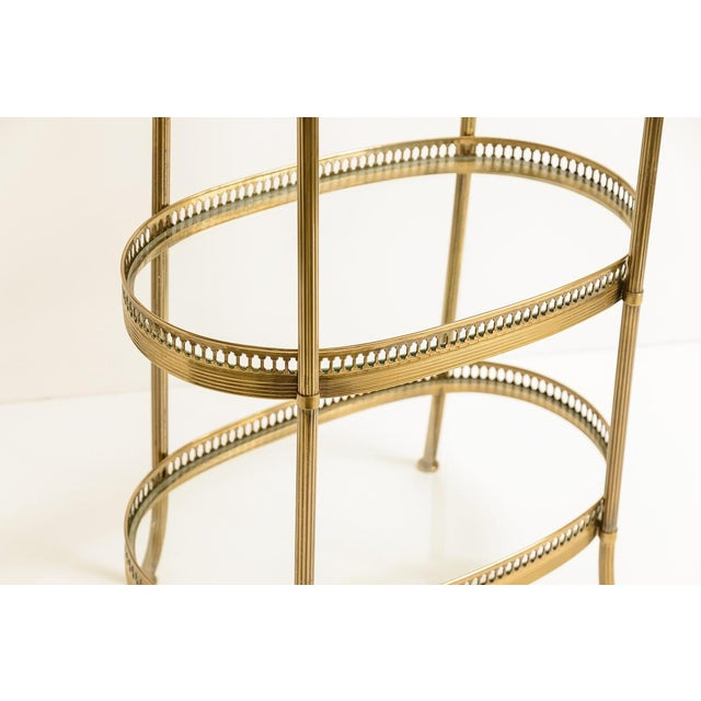 Fabulous petite french oval brass three-tiered small side tables, decorated with oval pierced galleries. This table is...