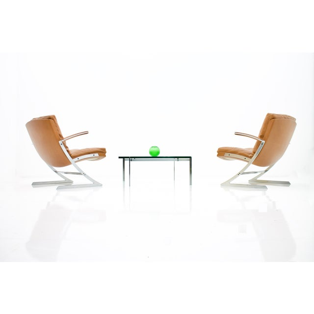 Pair of very rare Lobby chairs by Preben Fabricius for Arnold Exclusiv, 1972. Fiberglass shell, cushion with down, leather...