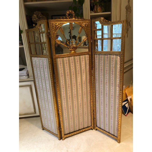 A sublimely elegant versatile antique French neoclassical folding screen having central panel with cresting of a garland...